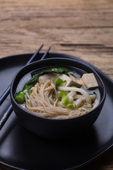 Japanese udon noodle soup with tofu and vegetables.
