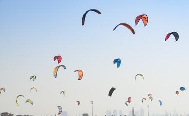 Kite surf kites flying over Jumeirah public beach in Dubai, UAE.