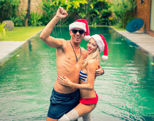 Couple having fun during winter holidays in tropical villa