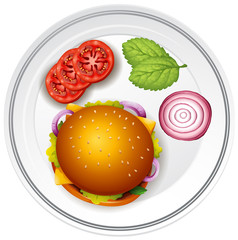 Hamburger and fresh vegetables on the plate