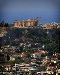 Parthenon famous temple and Plaka old neighborhood under acropolis hill, Athens Greece