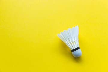 Badminton shuttlecock on yellow background