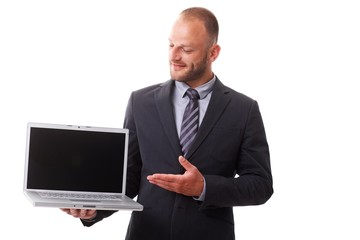 Businessman holding laptop with blank screen