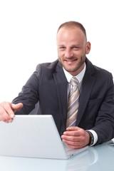 Happy businessman shutting down laptop