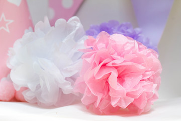 Closeup image of tissue pompoms for kid's birthday party