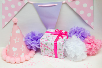 Present and decorations for surprise birthday party of little girl