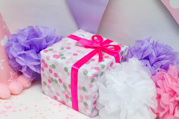 Closeup image of present and decorations for kid's birthday party