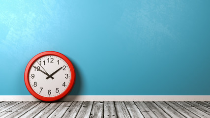 Clock on Wooden Floor Against Wall