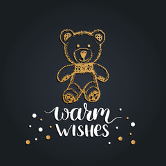 Warm Wishes lettering on black background. Vector hand drawn Christmas illustration of toy plush bear.