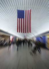 USA flag in railway station blurred