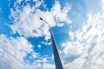 Low Angle View Of Metallic Street Lamp Against Cloudy Blue Sky