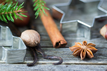 Cinnamon, anise, nutmeg with cutlery for Christmas cookies on the table.