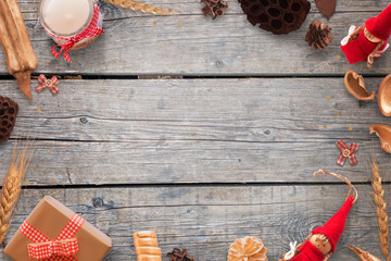 Gold and red color Christmas decorations on wooden table. Background image for text. Top view.