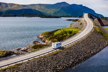 Caravan car RV travels on the highway Atlantic Ocean Road Norway.