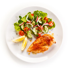 Grilled chicken fillet on white background