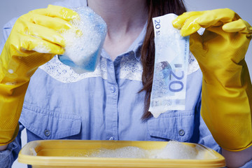 Laundering and legalization of money. Beautiful young woman washes money. (Shadow money, bribe, bribery concept)