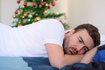 Man lying in bed with negative feelings and emotions