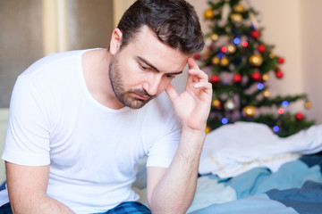 Portrait of man feeling negative emotions during holidays celebration