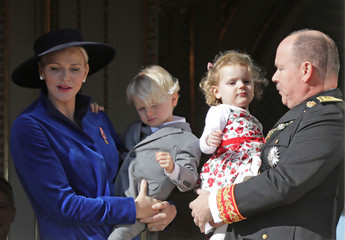 Prince Albert II of Monaco and his wife Princess Charlene hold their twins Prince Jacques and Princess Gabriella as they stand at the Palace Balcony during the celebrations marking Monaco's National Day
