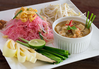 Stir Fried Noodle with coconut milk in white dish Thai food