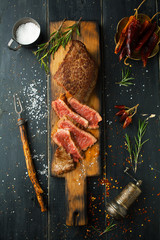 Grilled steak with spices and herbs