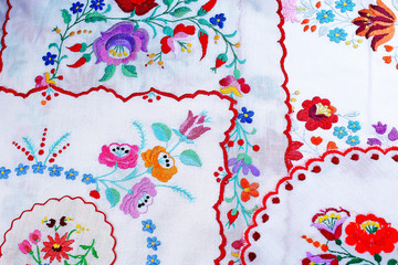 Embroidery. Patchwork handwork embroidery closeup texture pattern studio photo background. Hungarian.