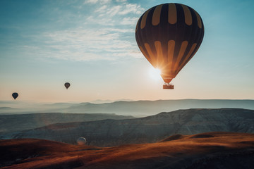 Hot air balloons flying over the valley at Cappadocia. Turkey
