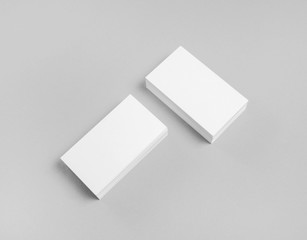 Photo of blank business cards on paper background. Template for ID. Mock-up for branding identity. Top view.