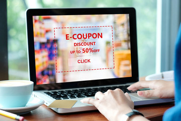 Woman hands typing laptop to get the grocery shopping on line discount coupon promotion, on line shopping ,digital marketing business and technology, lifestyle concept