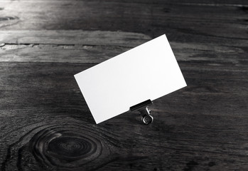 Blank white business card on wood background. Template for ID with plenty of copy space.
