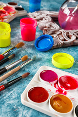 Gouache paints and art brushes for the artist with a copy space