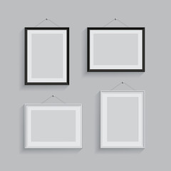 White and black picture or photo frames in different positions isolated on grey background. Vector frame set.