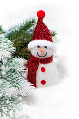 christmas snowman in fir branches on a white background