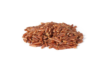 handful of red rice on white background