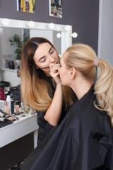 makeup artist doing eye make up