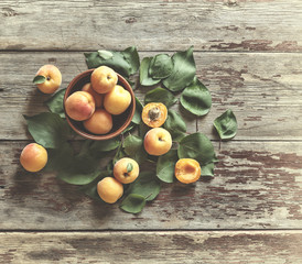 Ripe apricots on a wooden background. Top view. Vintage