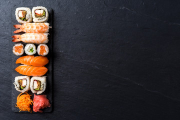 Printed kitchen splashbacks Sushi bar Overhead shot of Japanese sushi on black concrete background