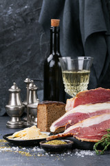 Prosciutto Ham served on a rustic wooden board