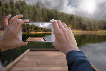 First person perspective of world traveler hands documenting trip on smartphone