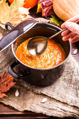 Image of useful soup puree, pumpkin on linen cloth