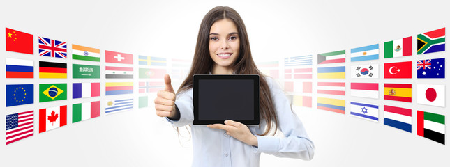 international language school concept smiling woman with like thumb up showing digital tablet on...