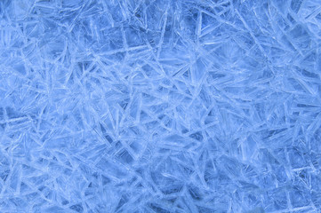 Frozen ice crystals. Simple white blue winter background