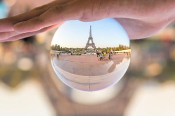 The Eiffel tower seen through a crystal ball, Paris France