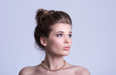Beauty portrait. Beautiful young woman with luxury decoration