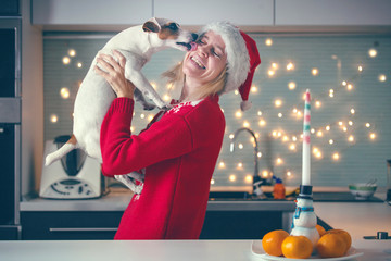 Woman with dog at christmas hat