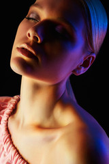 Fashion model woman in colorful bright lights