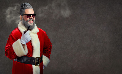 Santa Claus with a hairstyle and a cigar launches a smoke.
