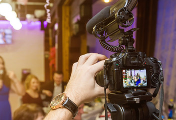 Wedding recording with the camera.Selective focus on the camera