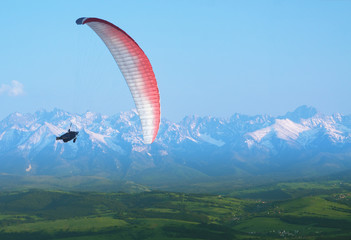 Paraglider in mid-air, Snow Covered Tatra Mountains