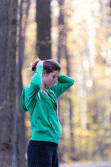 Fitness lifestyle concept of woman fixing hair before a run.